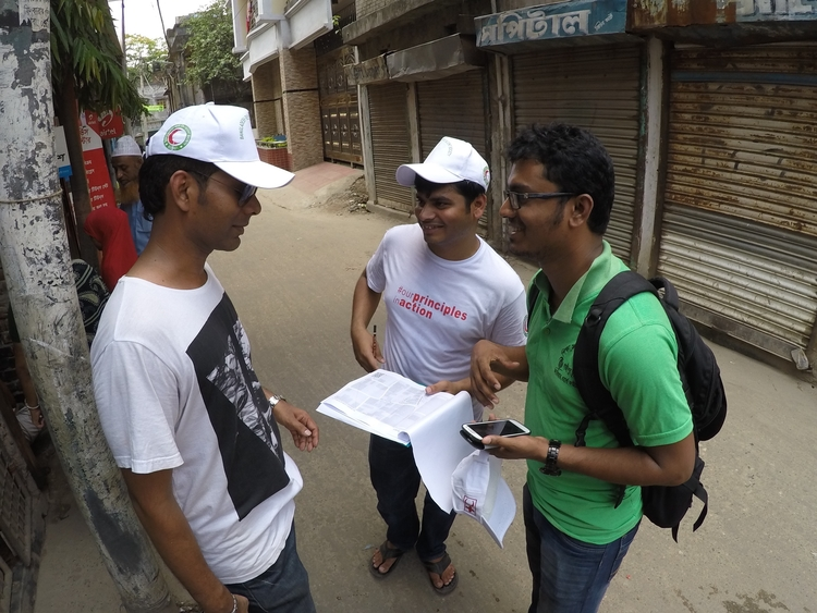 three men planning a field survey to collect OpenStreetMap data